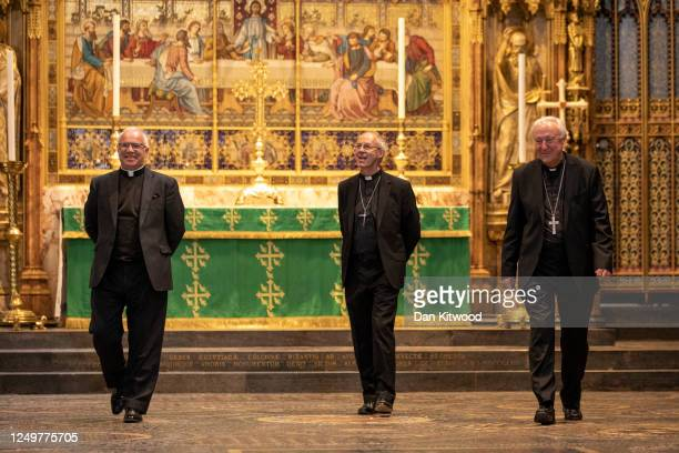 Dean of Westminster David Hoyle, Archbishop of Canterbury Justin Welby and Archbishop of Westminster Vincent Nichols walk to the shrine of Edward the...