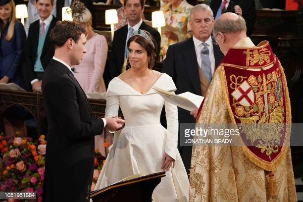 TOPSHOT Dean of Windsor David Conner presides over the wedding ceremony of Britain's Princess Eugenie of York and Jack Brooksbank at St George's...
