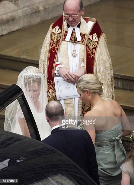 Dean of Windsor Reverend David Conner looks on as Autumn Kelly 31 British royal family member Zara Phillips enter St George's Chapel in Windsor on...