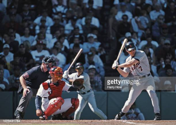 Dean Palmer and Third Baseman for the Detroit Tigers prepares to swing at the pitch as Red Sox catcher Jason Varitek and Home Plate umpire Ted...