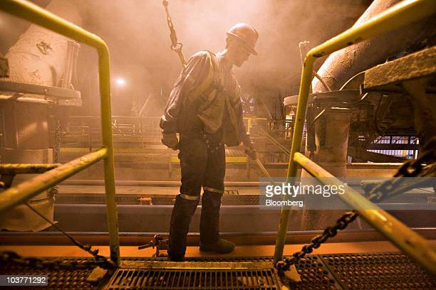 Dean Puetz a mill operator at the Potash Corp of Saskatchewan Lanigan mine prepares railcars for transferring potash at the company's facility in...
