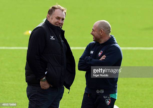 Dean Richards Director of Rugby of Newcastle Falcons speaks with Richard Cockerill of Leicester Tigers ahead of the Aviva Premiership match between...