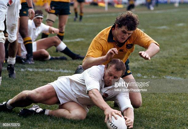 Dean Richards of England is tackled by Tim Gavin of Australia during the Test Match at the Sydney Football Stadium on 27th July 1991 Australia won...
