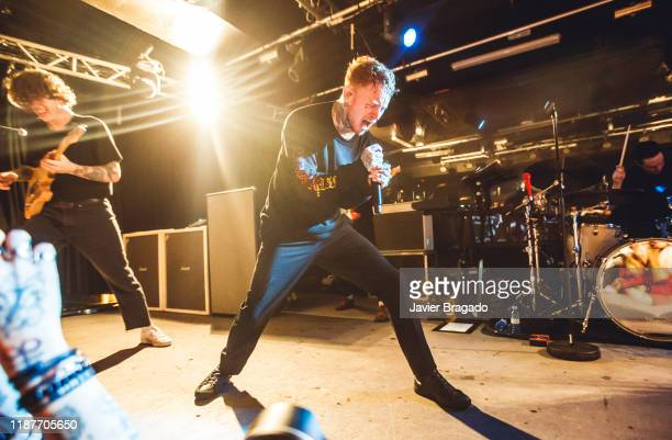 Dean Richardson Frank Carter and Gareth Grover from the band 'Frank Carter and The Rattlesnakes' perform on stage at Sala Mon on November 14 2019 in...