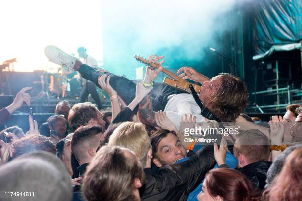 Dean Richardson of Frank Carter The Rattlesnakes performs while crowd surfing headlining the main stage on day 2 of The Legitimate Peaky Blinders...