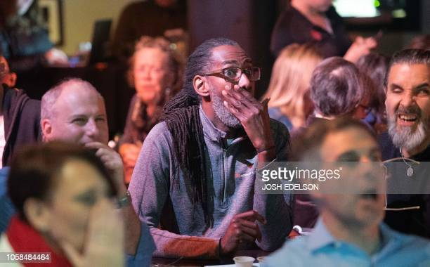 TOPSHOT Dean Samuels reacts as CNN predicts Republicans will maintain control of the Senate during an election viewing party at a bar called Piano...