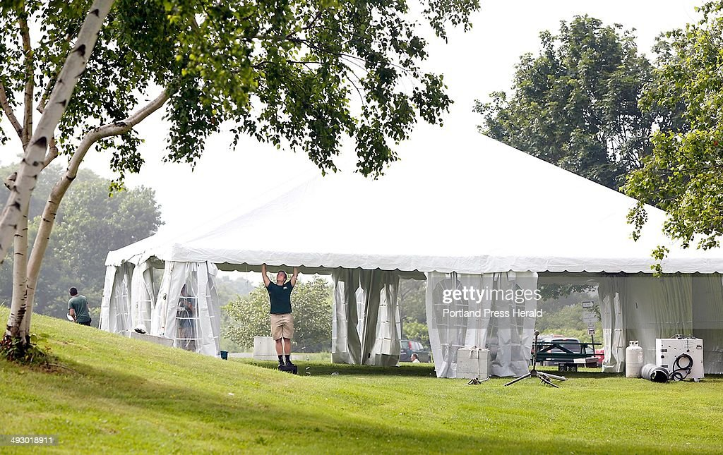Dean Samuelson of Wallace Tent and Party Rentals works on a tent as workers construct a & Dean Samuelson of Wallace Tent and Party Rentals works on a tent ...