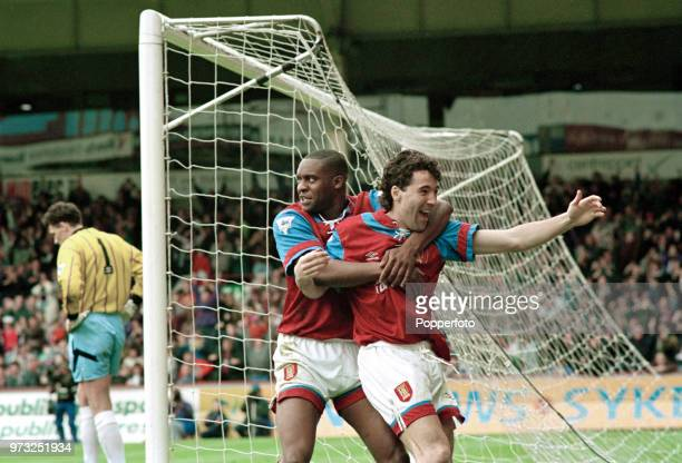 Dean Saunders of Aston Villa celebrates with teammate Dalian Atkinson after scoring during the FA Premier League match between Aston Villa and...