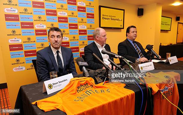 Dean Saunders the head coach / manager of Wolverhampton Wanderers with Steve Morgan the owner / chairman of Wolverhampton Wanderers and Jez Moxey the...