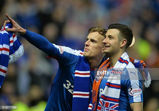 Dean Shiels and Jason Holt of Rangers celebrate as Rangers beat Dumbarton 10 to clinch the Scottish Championship title during the match between...