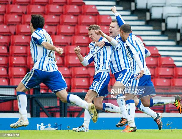 Dean Shiels of Kilmarnock celebrates putting them through to the final with his goal during the Scottish Communities Cup Semi Final match between Ayr...
