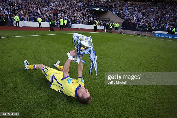 Dean Shiels of Kilmarnock celebrates withthe trophy after beating Celtic 10 in the Scottish Communities League Cup Final between Celtic and...