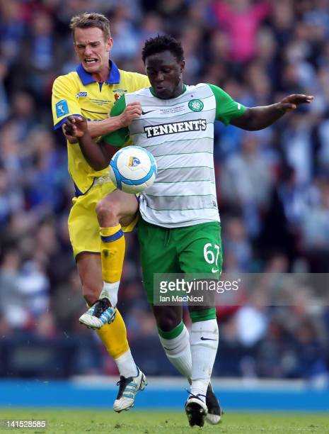 Dean Shiels of Kilmarnock competes for the ball with Victor Wanyama of Celtic during the Scottish Communities League Cup Final between Celtic and...