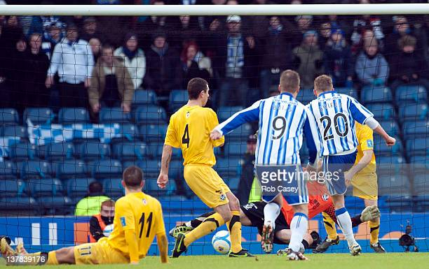Dean Shiels of Kilmarnock scores the only goal during the Scottish Communities Cup Semi Final match between Ayr United and Kilmarnock at Hampden Park...