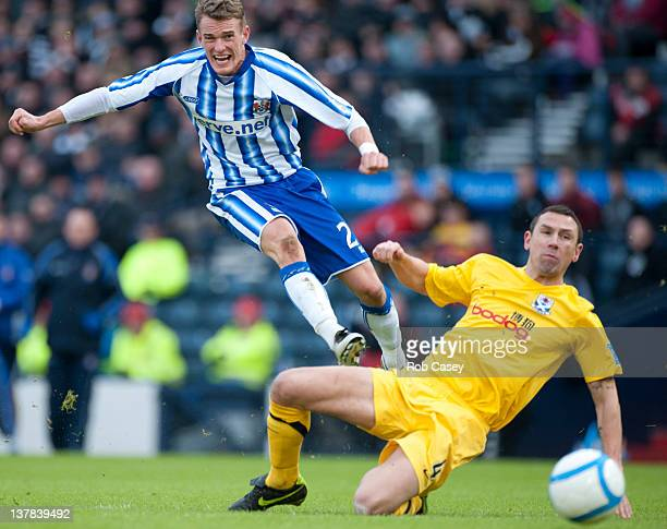 Dean Shiels of Kilmarnock shoots as John Robertson of Ayr defends during the Scottish Communities Cup Semi Final match between Ayr United and...