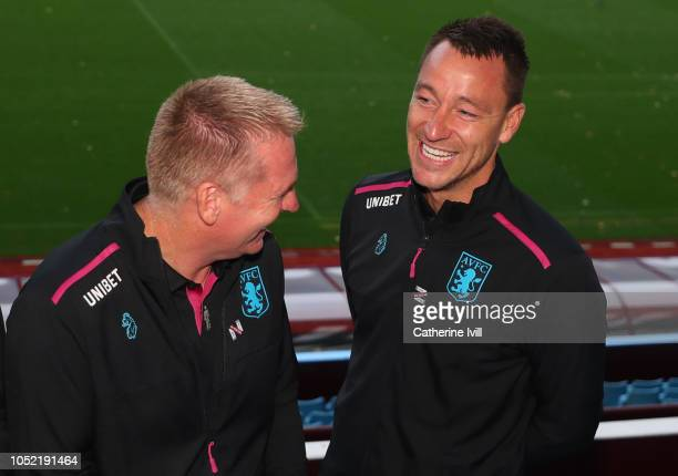 Dean Smith manager and John Terry assistant manager of Aston Villa share a joke during a press conference at Villa Park Stadium on October 15 2018 in...