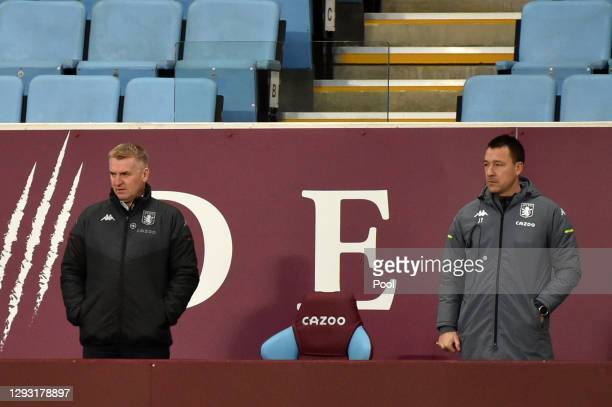 Dean Smith, Manager of Aston Villa and Assistant Coach, John Terry looks on during the Premier League match between Aston Villa and Crystal Palace at...
