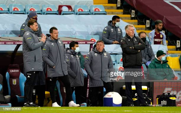 Dean Smith, Manager of Aston Villa and John Terry, Assistant Coach of Aston Villa looks on during the Premier League match between Aston Villa and...