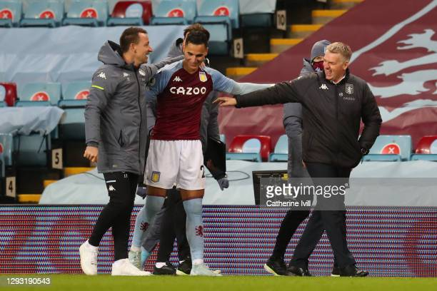 Dean Smith, Manager of Aston Villa and John Terry, Assistant Coach of Aston Villa embrace Anwar El Ghazi of Aston Villa following their sides victory...