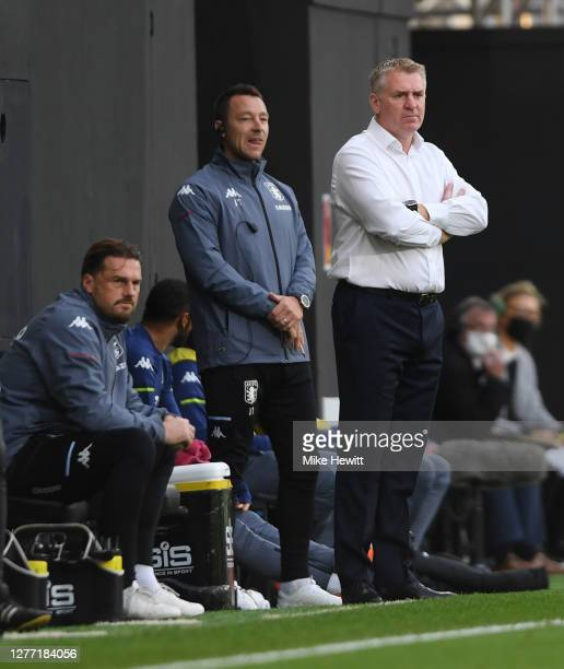 Dean Smith, Manager of Aston Villa and John Terry, Assistant Manager of Aston Villa look on during the Premier League match between Fulham and Aston...