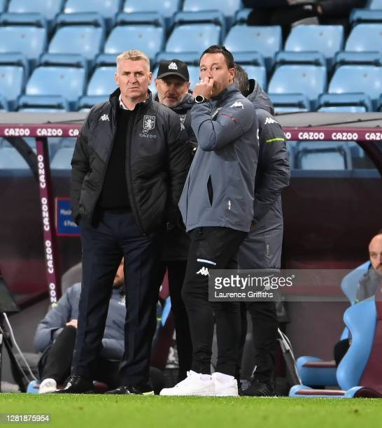 Dean Smith Manager of Aston Villa and John Terry Assistant Manager of Aston Villa look on during the Premier League match between Aston Villa and...