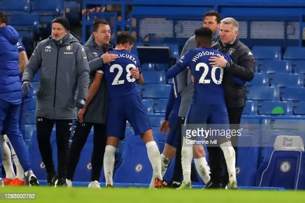 Dean Smith , manager of Aston Villa and John Terry , assistant manager of Aston villa interact with Callum Hudson-Odoi and Cesar Azpilicueta of...
