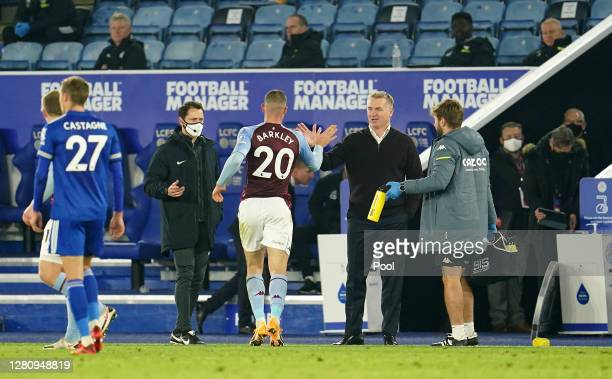 Dean Smith Manager of Aston Villa and Ross Barkley of Aston Villa celebrate following their sides victory in the Premier League match between...