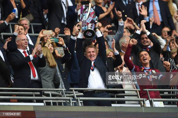 Dean Smith Manager of Aston Villa celebrates with the Sky Bet Championship Playoff Final Trophy following his team's victory in the Sky Bet...