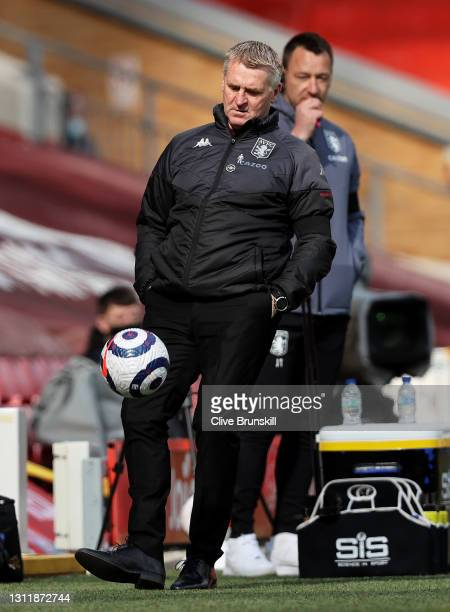 Dean Smith, Manager of Aston Villa controls the ball during the Premier League match between Liverpool and Aston Villa at Anfield on April 10, 2021...