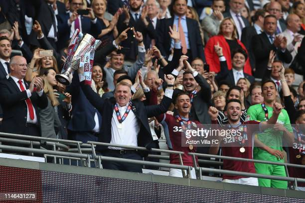Dean Smith, Manager of Aston Villa lifts the Play Off Trophy following victory in the Sky Bet Championship Play-off Final match between Aston Villa...
