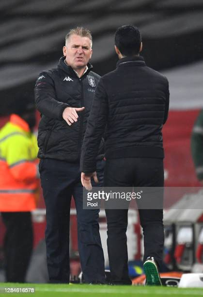 Dean Smith Manager of Aston Villa shakes hands with Mikel Arteta Manager of Arsenal following the Premier League match between Arsenal and Aston...