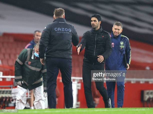 Dean Smith Manager of Aston Villa shakes hands with Mikel Arteta Manager of Arsenal during the Premier League match between Arsenal and Aston Villa...
