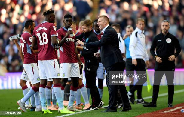 Dean Smith Manager of Aston Villa talks to Tammy Abraham of Aston Villa during the Sky Bet Championship match between Aston Villa and Swansea City at...
