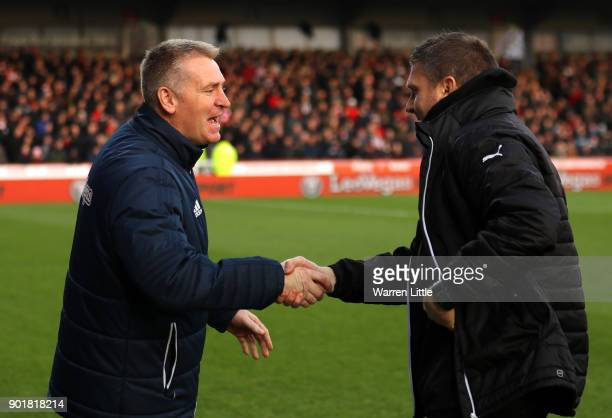 Dean Smith Manager of Brentford greets Kevin Nolan Player/Manager of Notts County prior to The Emirates FA Cup Third Round match between Brentford...