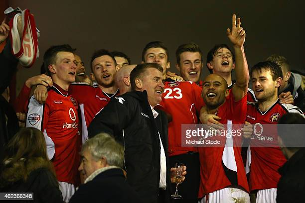 Dean Smith the manager of Walsall flanked by James Chambers celebrate reaching the final after their 20 victory during the Johnstone's Paint Northern...