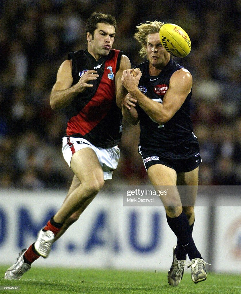 Dean Solomon #7 for the Bombers and David Teague #15 for the Blues compete for the ball during the round four AFL match between the Carlton Blues and the Essendon Bombers at the Melbourne Cricket Ground April 16, 2004 in Melbourne, Australia.
