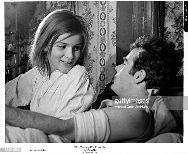 Dean Stockwell and Patricia Gozzi sitting and talking with one an other in a scene from the film 'Rapture' 1965