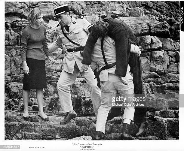 Dean Stockwell gets carried away as Patricia Gozzi watches in distress in a scene from the film 'Rapture' 1965