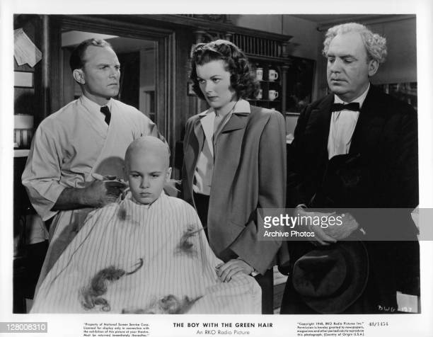 Dean Stockwell gets his hair completely cut in the barber shop while Barbara Hale and Pat O'Brien watch in a scene from the film 'The Boy With The...