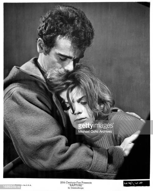 Dean Stockwell holding Patricia Gozzi in his arms and comforting her in a scene from the film 'Rapture' 1965