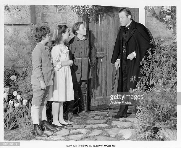 Dean Stockwell Margaret O'Brien and Brian Roper all look over to Herbert Marshall in a scene from the film 'The Secret Garden' 1949