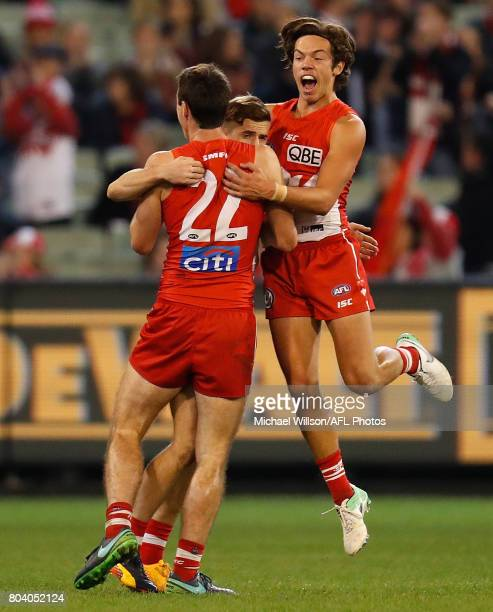 Dean Towers Jake Lloyd and Oliver Florent of the Swans celebrate during the 2017 AFL round 15 match between the Melbourne Demons and the Sydney Swans...