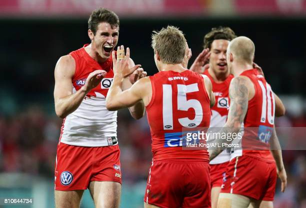 Dean Towers of the Swans celebrates with team mates after kicking a goal during the round 16 AFL match between the Sydney Swans and the Gold Coast...
