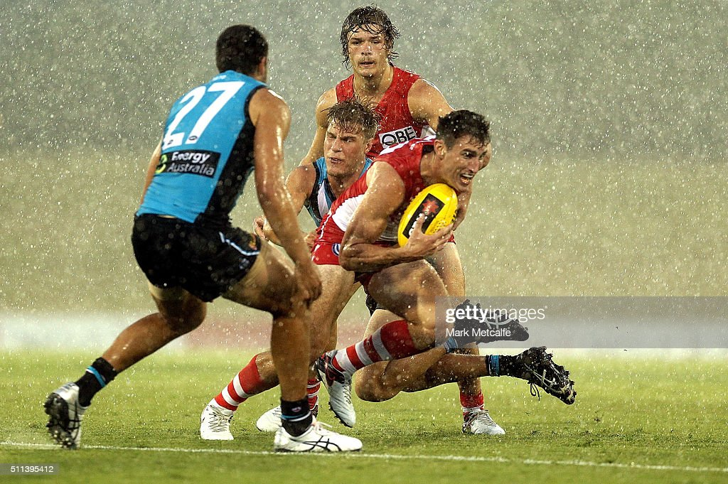 Dean Towers of the Swans evades a tackle during the 2016 NAB Challenge AFL match between the Sydney Swans and Port Adelaide Power at Blacktown International Sportspark on February 20, 2016 in Sydney, Australia.