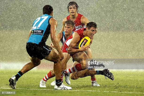 Dean Towers of the Swans evades a tackle during the 2016 NAB Challenge AFL match between the Sydney Swans and Port Adelaide Power at Blacktown...