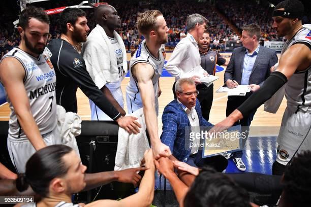 Dean Vickerman head coach of Melbourne United talks to his players during game two of the NBL Grand Final series between the Adelaide 36ers and...