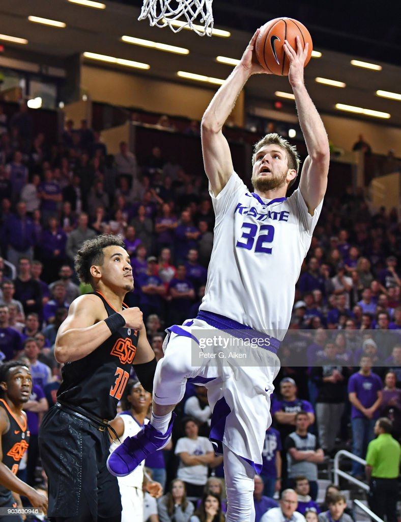 Dean Wade #32 of the Kansas State Wildcats drives to the basket against Jeffrey Carroll #30 of the Oklahoma State Cowboys of the Oklahoma State Cowboys during the second half on January 10, 2018 at Bramlage Coliseum in Manhattan, Kansas.