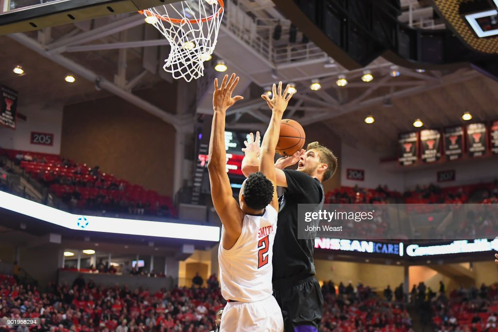 Dean Wade #32 of the Kansas State Wildcats goes to the basket against Zhaire Smith #2 of the Texas Tech Red Raiders during the game on January 6, 2018 at United Supermarket Arena in Lubbock, Texas. Texas Tech won the game 74-58.