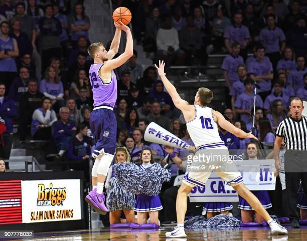 Dean Wade of the Kansas State Wildcats hits a threepoint shot over Vladimir Brodziansky of the TCU Horned Frogs during the first half on January 20...