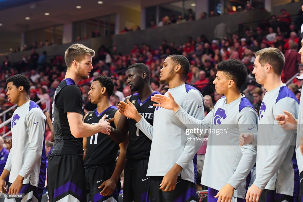 Dean Wade #32 of the Kansas State Wildcats in congratulated by teammates as he leaves the game against the Texas Tech Red Raiders on January 6, 2018 at United Supermarket Arena in Lubbock, Texas. Texas Tech won the game 74-58.